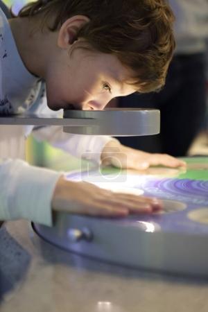 Preschooler with microscope