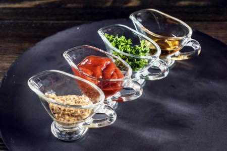 Different sauces in glass saucers