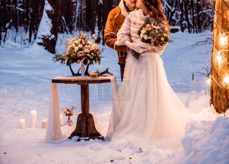 wedding couple in  wood