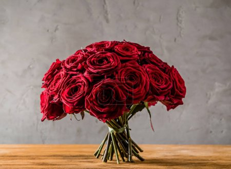 Photo for Bunch of red roses on table - Royalty Free Image
