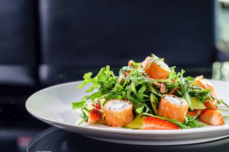 Photo for Salad with salmon rolls and arugula - Royalty Free Image