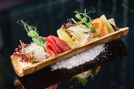 Photo for Delicious sashimi served in bamboo - Royalty Free Image