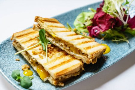 tasty sandwich with grilled bread