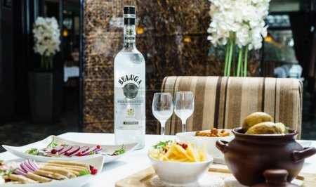 Bottle of Beluga vodka on table