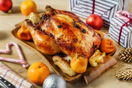 roasted chicken on Christmas table, close up