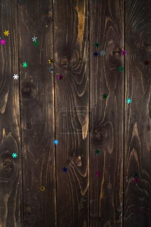 colorful snowflakes on the wooden background