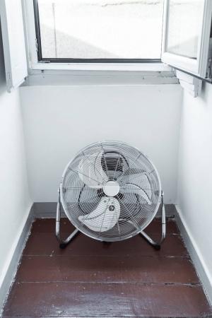 electric fan  near window, close up