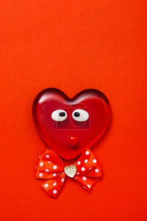 Red Valentine heart on red background