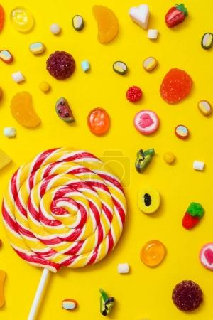 colorful candies on the yellow background