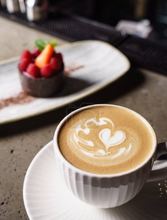 cup of cappuccino on table, close up