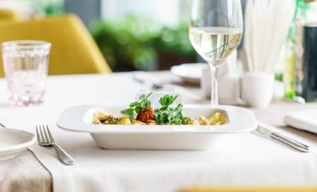 Photo for Dinner in the italian restarant, close up - Royalty Free Image