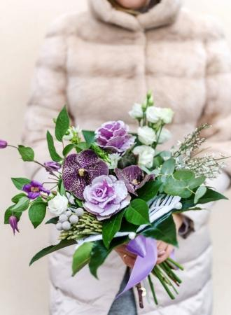nice bouquet in the hands of woman