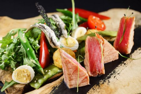 fresh tuna with salad, close up