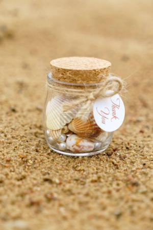 bottle with shells, close up