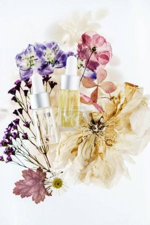 homemade cleansing oil and flowers