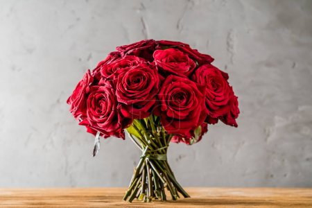 Photo for Red roses on wooden table, close up - Royalty Free Image