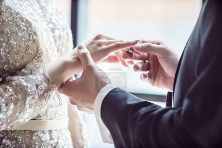 couple on wedding ceremony, close up on hands