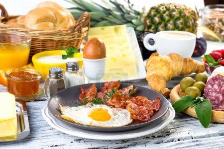 Photo for Breakfast with coffee, orange juice, croissant, egg, yogurt, vegetables, fruits - Royalty Free Image