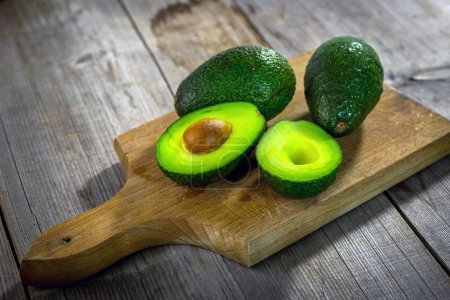 Photo for Fresh ripe avocados wooden background - Royalty Free Image