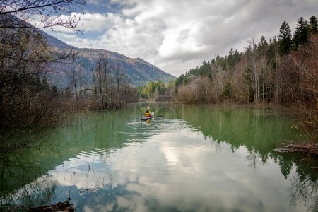 Kayaker on river Ribnica
