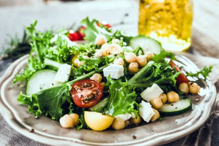 Photo for Fresh healthy salad with chickpeas on plate - Royalty Free Image
