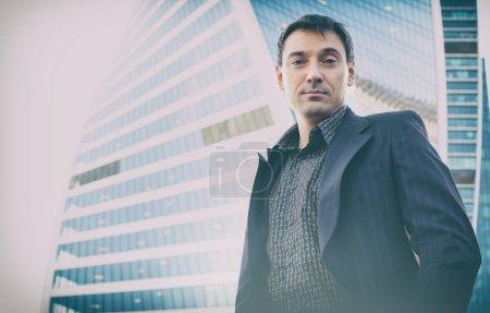Outdoor portrait of successful businessman
