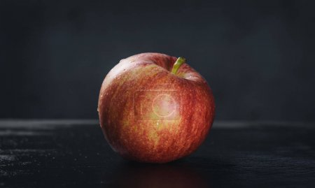 Photo for Fresh red apple on a dark background - Royalty Free Image
