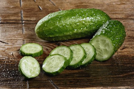Photo for Fresh cucumber slices on wooden table close up - Royalty Free Image