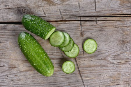 Photo for Fresh Cucumber slices on wood background. Top view - Royalty Free Image