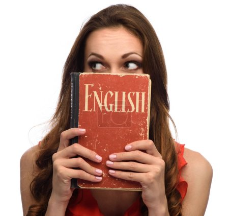 Photo for Young girl show an English textbook. Isolated on white - Royalty Free Image
