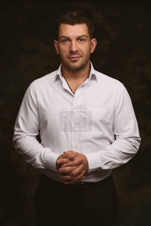 Photo for Portrait of handsome man looking at camera. Black background - Royalty Free Image