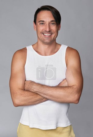 handsome smiling muscular man isolated