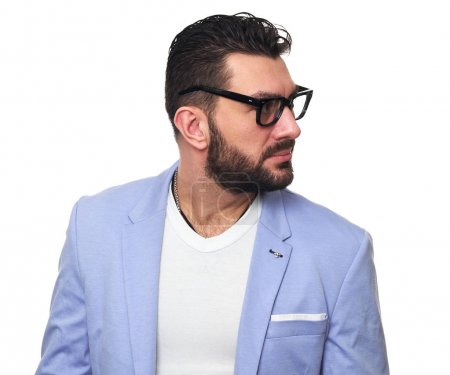 Photo for Handsome bearded man looking away. Isolated on white. Fashionable guy wearing spectacles and trendy jacket - Royalty Free Image