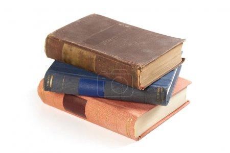 Photo pour Livres anciens isolés sur un fond blanc - image libre de droit