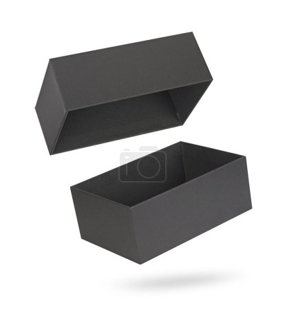 Photo for Black blank cardboard package box mockup. Isolated on white with clipping path - Royalty Free Image