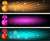 Set Christmas banners with balls and glowing rays
