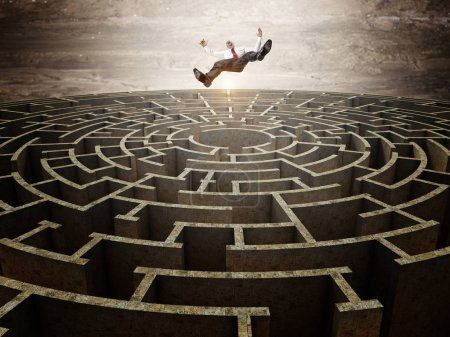 falling businessman and maze