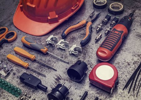 Photo for Electrician tools on metal background - Royalty Free Image