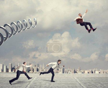 Photo for Business challenge, businessman take advantage using huge metal spring - Royalty Free Image