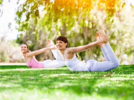 Young women exercising in the park