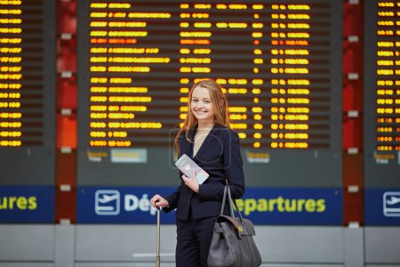 Young elegant business woman in international airport