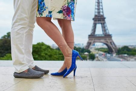 Couple near the Eiffel tower in Paris, closeup on legs