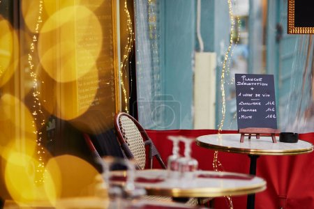 Parisian outdoor cafe with menu board on the table