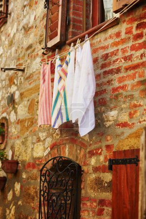 Typical Italian building with hanging linen