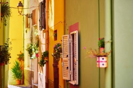 Typical colorful Italian houses on a street of Bosa, Sardinia, Italy