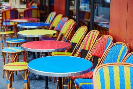 Photo for Colorful tables and chairs of empty outdoor cafe in Paris, France - Royalty Free Image