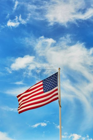 Photo for National flag of the United States of America over the blue sky - Royalty Free Image