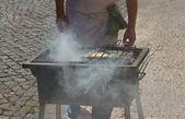 Fried fish on a hot coal.