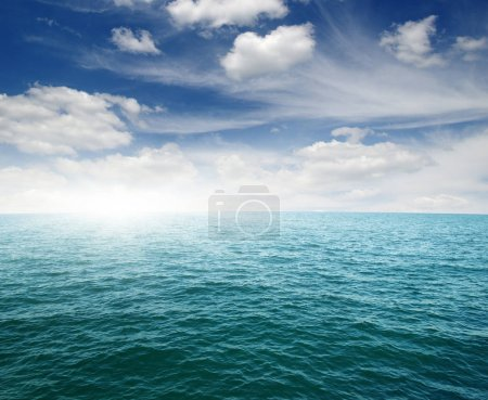 Photo for Blue sea and sun on sky - Royalty Free Image
