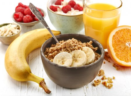Photo for Bowl of muesli with banana for healthy breakfast - Royalty Free Image
